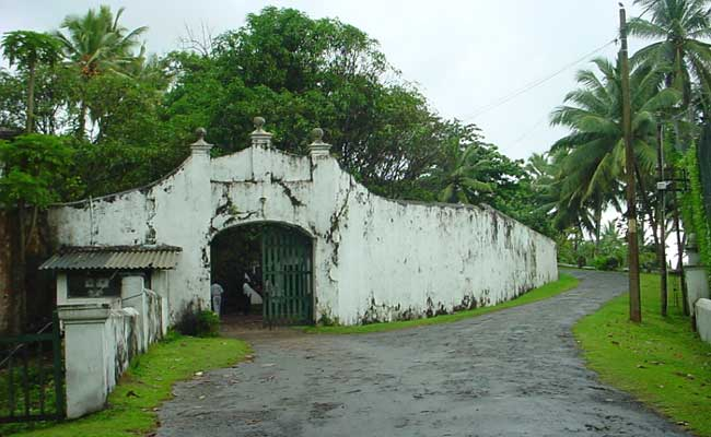 Entrance to the Stables and Servant's Quarters : The huge milk-white walls and the massive gate found at the entrance.