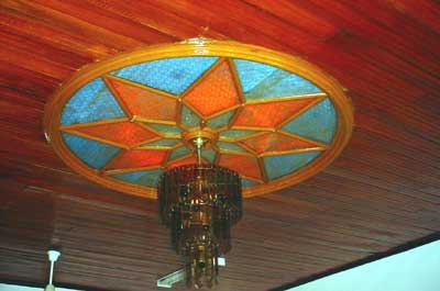 The ceiling has been refurbished, retaining some of the older ceiling lights.